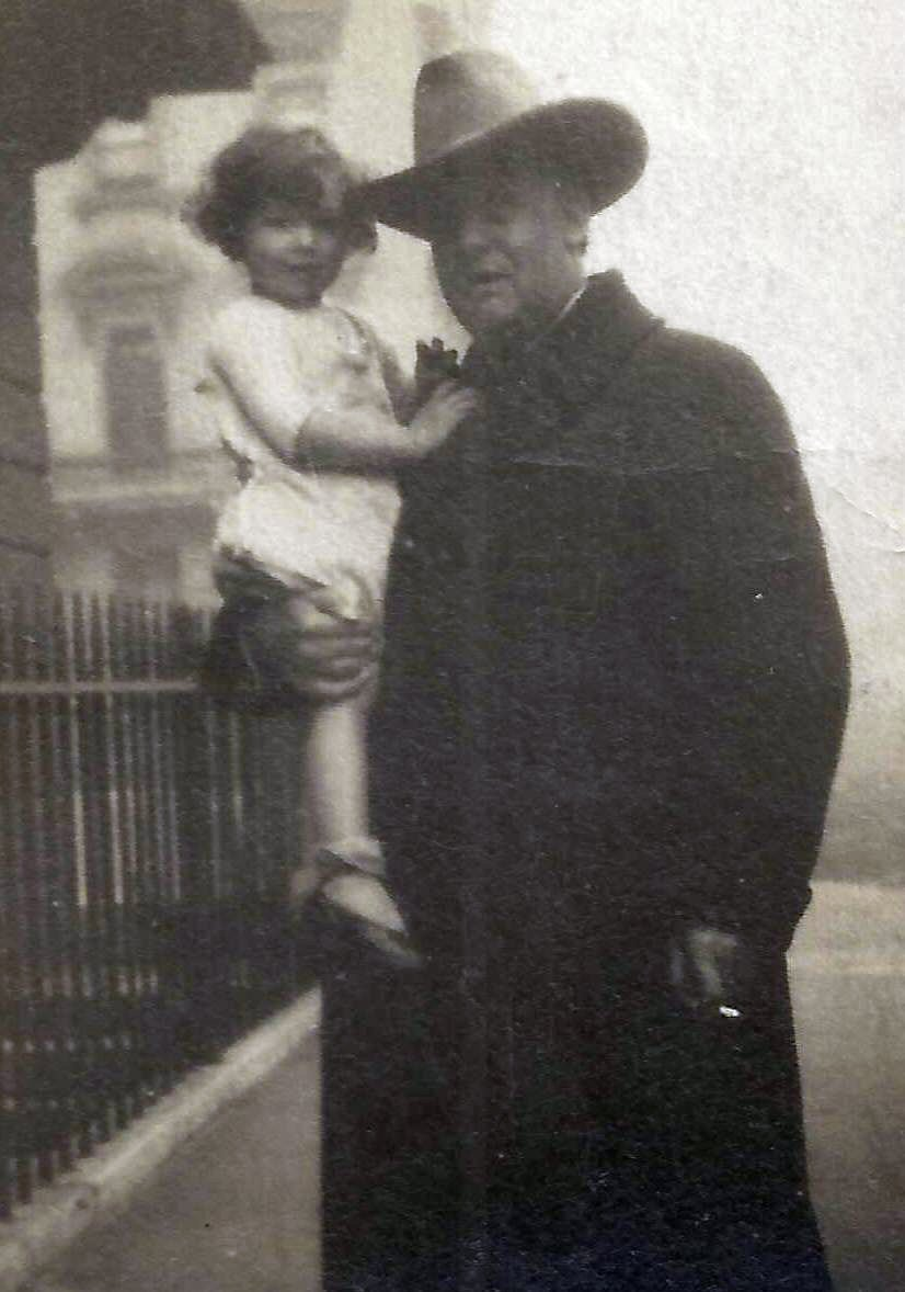 Thomas Douglas Hamilton Garside ('John Craven' wearing a large hat made by Christies of Southport) holding his daughter Hathor c.1926 at St Georges Drive Pimlico SW1